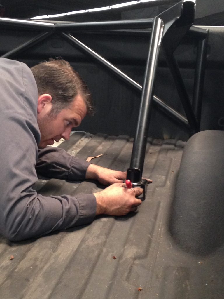 Rebel Technician Chris Paul installing ReadyLIFT Off-Road Bedcage